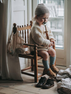 kids photography, kids photography ideas at home, kids fashion, Petit Nord sandals, boy wearing sandals by petit nord, sitting in a chair